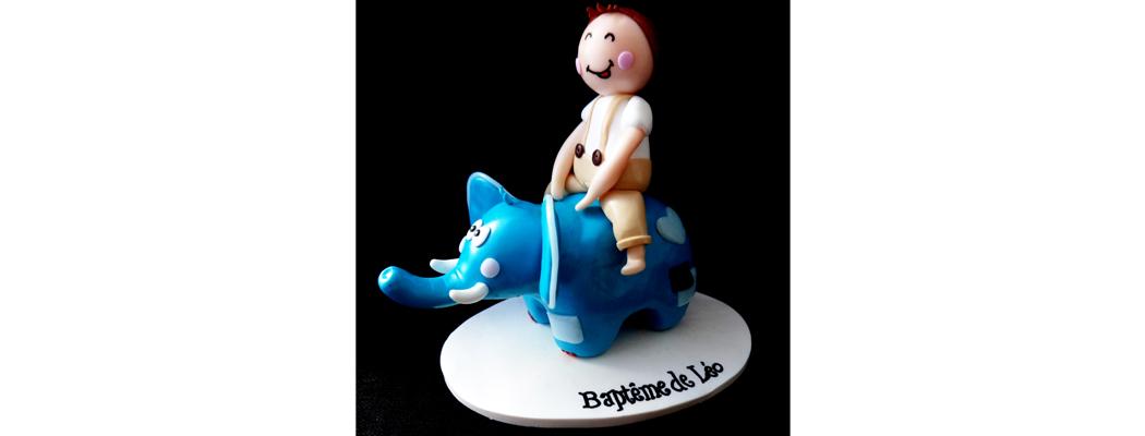 Figurine Baptême – Léo à dos d'éléphant – Fée Plaisir